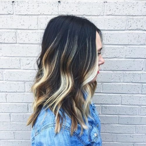 bright blonde balayage dark hair